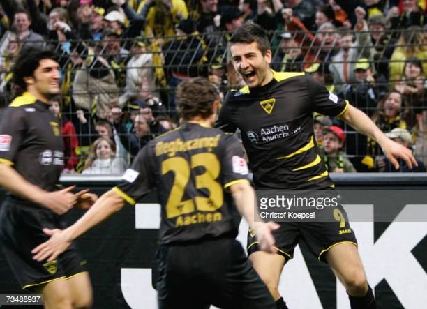 Vedad Ibisevic of Aachen celebrates his second goal with Laurentiu Reghecampf during the Bundesliga match between Alemannia Aachen and FSV Mainz 05...