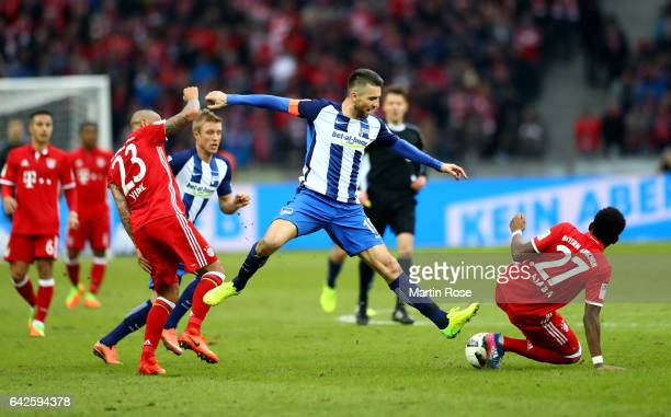 Vedad Ibisevic of Berlin and Arturo Vidal of Muenchen battle for the ball during the Bundesliga match between Hertha BSC and Bayern Muenchen at...