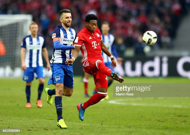 Vedad Ibisevic of Berlin and David Alaba of Muenchen battle for the ball during the Bundesliga match between Hertha BSC and Bayern Muenchen at...
