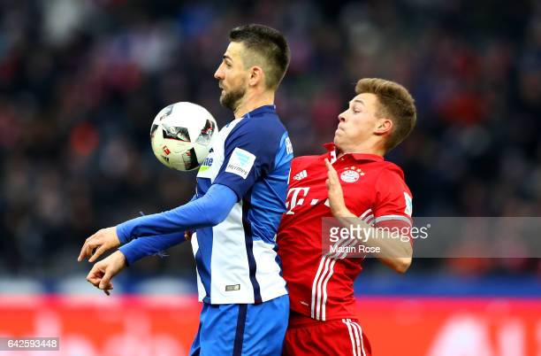 Vedad Ibisevic of Berlin and Joshua Kimmich of Muenchen battle for the ball during the Bundesliga match between Hertha BSC and Bayern Muenchen at...