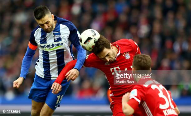 Vedad Ibisevic of Berlin and Mats Hummels of Muenchen head for the ball during the Bundesliga match between Hertha BSC and Bayern Muenchen at...