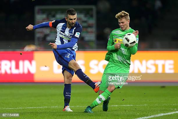 Vedad Ibisevic of Berlin battles for the ball with Nico Elvedi of Moenchengladbach during the Bundesliga match between Hertha BSC and Borussia...