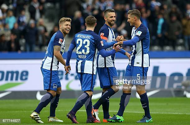 Vedad Ibisevic of Berlin celebrates with team mates after scoring the first goal during the Bundesliga match between Hertha BSC and 1 FC Koeln at...