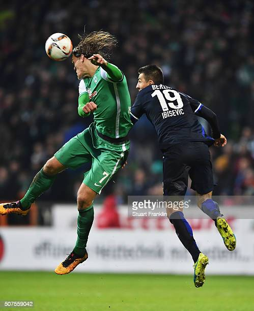 Vedad Ibisevic of Berlin is challenged by Jannik Vestergaard of Bremen during the Bundesliga match between Werder Bremen and Hertha BSC at...