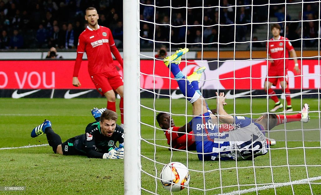 Vedad Ibisevic (C) of Berlin scores his team's first goal against goalkeeper Ron-Robert Zieler (L) of Hannover during the Bundesliga match between Hertha BSC and Hannover 96 at Olympiastadion on April 8, 2016 in Berlin, Germany.