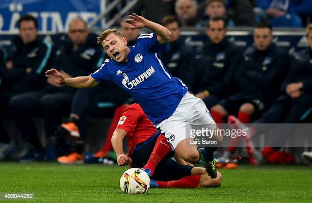 Vedad Ibisevic of Berlin tackles Max Meyer of Schalke during the Bundesliga match between FC Schalke 04 and Hertha BSC Berlin at VeltinsArena on...