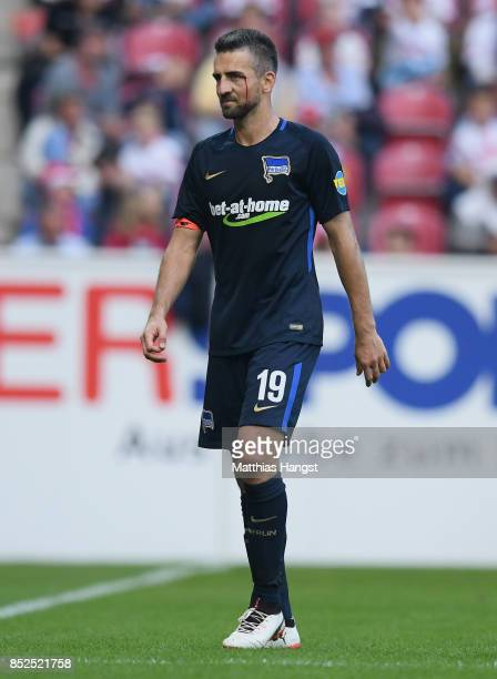 Vedad Ibisevic of Berlin walks of the pitch after a red card during the Bundesliga match between 1 FSV Mainz 05 and Hertha BSC at Opel Arena on...