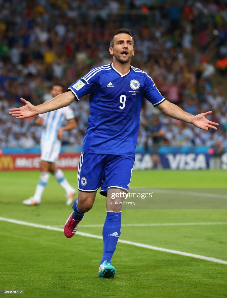 <a gi-track='captionPersonalityLinkClicked' href=/galleries/search?phrase=Vedad+Ibisevic&family=editorial&specificpeople=535857 ng-click='$event.stopPropagation()'>Vedad Ibisevic</a> of Bosnia and Herzegovina celebrates scoring his team's first goal during the 2014 FIFA World Cup Brazil Group F match between Argentina and Bosnia-Herzegovina at Maracana on June 15, 2014 in Rio de Janeiro, Brazil.