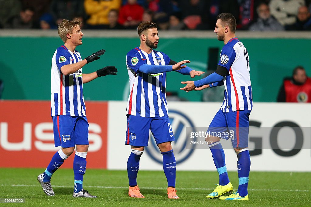 <a gi-track='captionPersonalityLinkClicked' href=/galleries/search?phrase=Vedad+Ibisevic&family=editorial&specificpeople=535857 ng-click='$event.stopPropagation()'>Vedad Ibisevic</a> of Hertha Berlin celebrates with teammates <a gi-track='captionPersonalityLinkClicked' href=/galleries/search?phrase=Marvin+Plattenhardt&family=editorial&specificpeople=5616506 ng-click='$event.stopPropagation()'>Marvin Plattenhardt</a> and <a gi-track='captionPersonalityLinkClicked' href=/galleries/search?phrase=Marvin+Plattenhardt&family=editorial&specificpeople=5616506 ng-click='$event.stopPropagation()'>Marvin Plattenhardt</a> after scoring his side's first goal during the DFB Cup quarter final match between 1. FC Heidenheim and Hertha BSC at Voith-Arena on February 10, 2016 in Heidenheim, Germany.