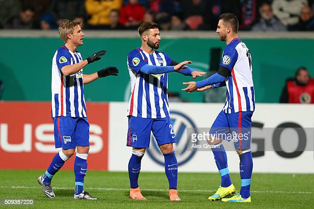 Vedad Ibisevic of Hertha Berlin celebrates with teammates Marvin Plattenhardt and Marvin Plattenhardt after scoring his side's first goal during the...