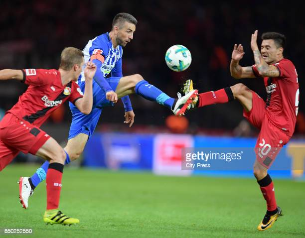 Vedad Ibisevic of Hertha BSC and Charles Aranguiz of Bayer 04 Leverkusen during the game between Hertha BSC and Bayer 04 Leverkusen on september 20...