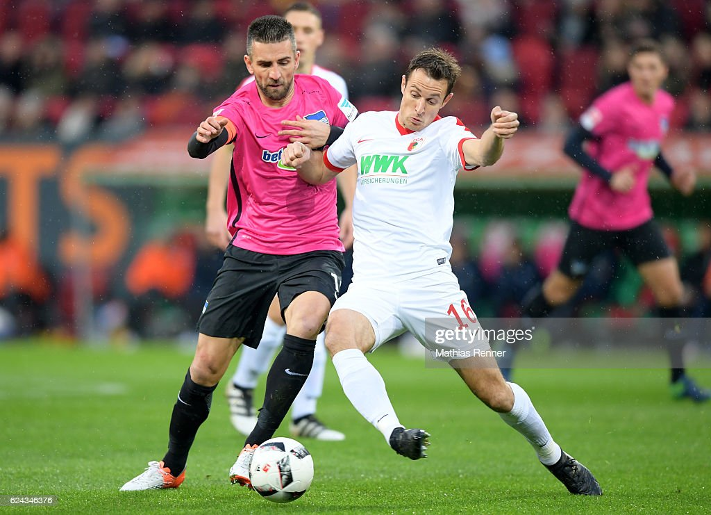 Vedad Ibisevic of Hertha BSC and Christoph Janker of FC Augsburg during the game between FC Augsburg and Hertha BSC on november 19, 2016 in Augsburg, Germany.