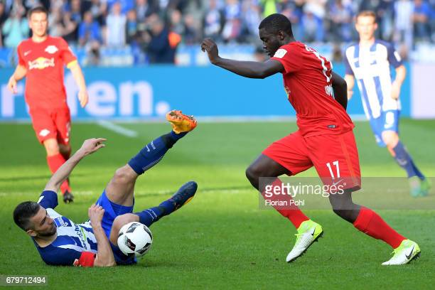 Vedad Ibisevic of Hertha BSC and Dayot Upamecano of RB Leipzig during the game between Hertha BSC and RB Leipzig on may 6 2017 in Berlin Germany