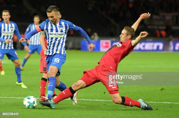 Vedad Ibisevic of Hertha BSC and Dominik Kohr of Bayer 04 Leverkusen during the game between Hertha BSC and Bayer 04 Leverkusen on september 20 2017...