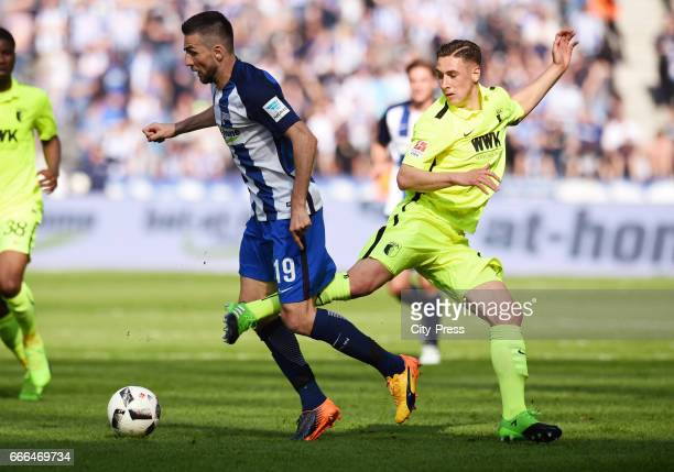 Vedad Ibisevic of Hertha BSC and Dominik Kohr of FC Augsburg during the game between Hertha BSC and FC Augsburg on April 9 2017 in Berlin Germany 1921