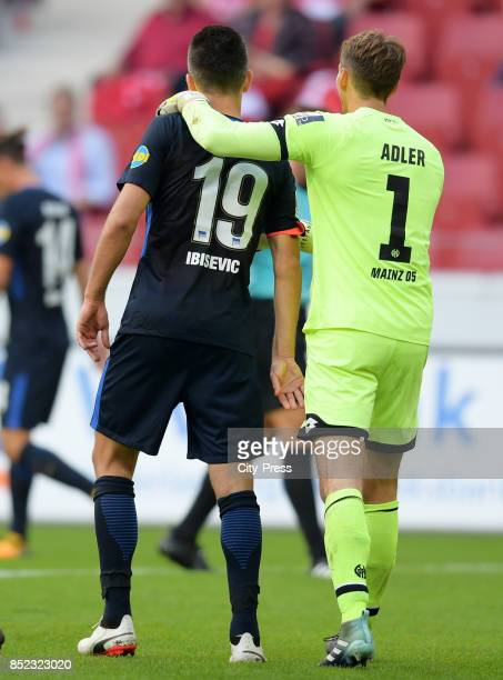 Vedad Ibisevic of Hertha BSC and René Adler of FSV Mainz 05 during the game between FSV Mainz 05 and Hertha BSC on september 23 2017 in Mainz Germany