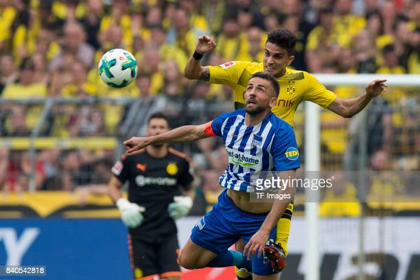 Vedad Ibisevic of Hertha BSC Berlin and Marc Bartra of Dortmund battle for the ball during the Bundesliga match between Borussia Dortmund and Hertha...