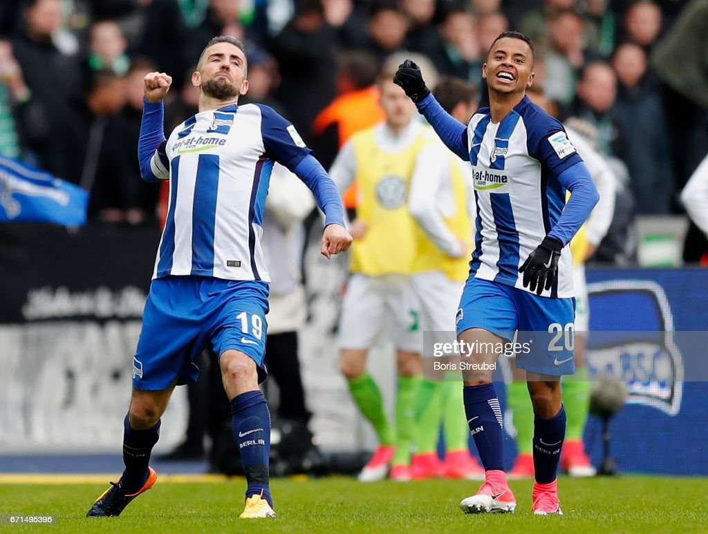 Vedad Ibisevic of Hertha BSC celebrates with team mate Allan of Hertha BSC after scoring his team's first goal during the Bundesliga match between Hertha BSC and VfL Wolfsburg at Olympiastadion on April 22, 2017 in Berlin, Germany.