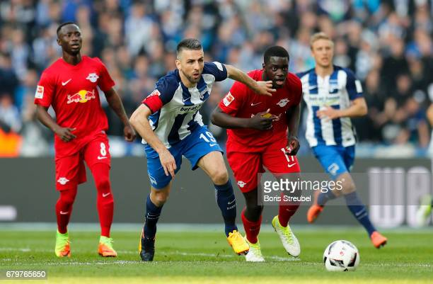 Vedad Ibisevic of Hertha BSC is challenged by Dayot Upamecano of RB Leipzig during the Bundesliga match between Hertha BSC and RB Leipzig at...
