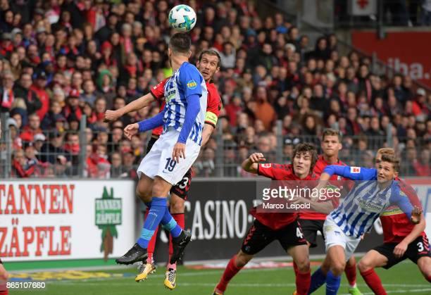 Vedad Ibisevic of Hertha BSC Julian Schuster Caglar Soeyuencue of SC Freiburg and Niklas Stark of Hertha BSC during the game between SC Freiburg and...