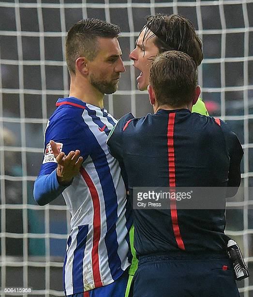Vedad Ibisevic of Hertha BSC Marwin Hitz of FC Augsburg and referee Tobias Stieler during the game between Hertha BSC and FC Augsburg on January 23...
