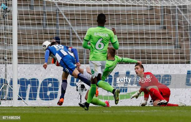 Vedad Ibisevic of Hertha BSC scores his team's first goal against goalkeeper Koen Casteels of VfL Wolfsburg with a header during the Bundesliga match...