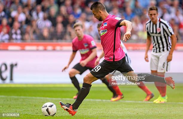 Vedad Ibisevic of Hertha BSC scores the first goal for his team with a penalty during to the Bundesliga match between Eintracht Frankfurt and Hertha...