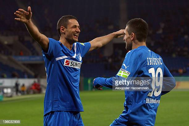 Vedad Ibisevic of Hoffenheim celebrates scoring the second team goal with his team mate Sejad Salihovic during the DFB Cup round of sixteen match...