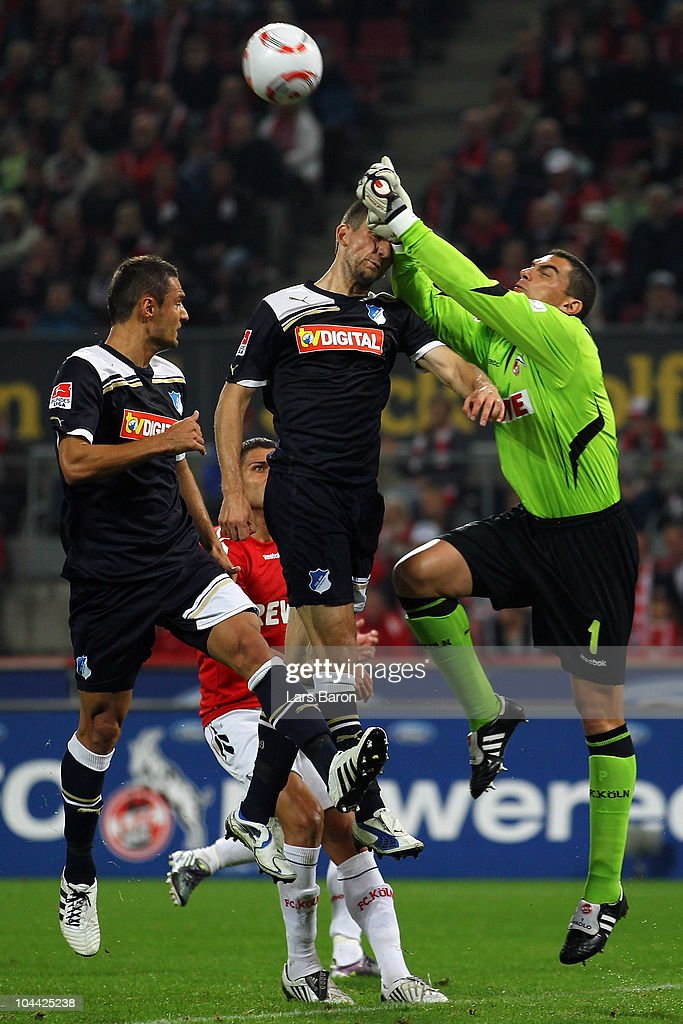 Vedad Ibisevic of Hoffenheim is challenged by goalkeeper Faryd Mondragon of Koeln during the Bundesliga match between 1. FC Koeln and 1899 Hoffenheim at RheinEnergieStadion on September 24, 2010 in Cologne, Germany.