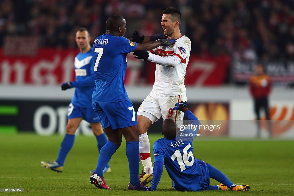 <a gi-track='captionPersonalityLinkClicked' href=/galleries/search?phrase=Vedad+Ibisevic&family=editorial&specificpeople=535857 ng-click='$event.stopPropagation()'>Vedad Ibisevic</a> (C) of Stuttgart argues with Khaleem Hyland and <a gi-track='captionPersonalityLinkClicked' href=/galleries/search?phrase=Anele+Ngcongca&family=editorial&specificpeople=6522439 ng-click='$event.stopPropagation()'>Anele Ngcongca</a> of Genk during the UEFA Europa League Round of 32 first leg match between VfB Stuttgart and KRC Genk at Mercedes-Benz Arena on February 14, 2013 in Stuttgart, Germany.