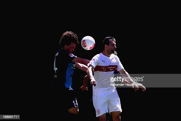 Vedad Ibisevic of Stuttgart battles for the ball with Julian Baumgartlinger of Mainz and his team mate Yunus Malli during the Bundesliga match...