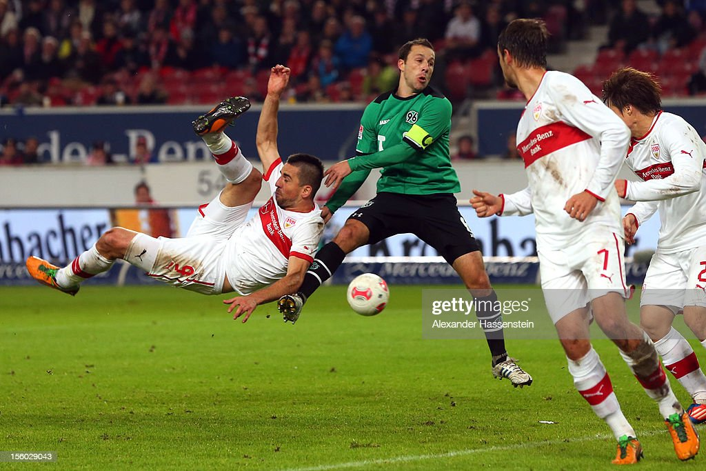 Vedad Ibisevic of Stuttgart battles for the ball with Steven Cherundolo of during the Bundesliga match between VfB Stuttgart and Hannover 96 at...