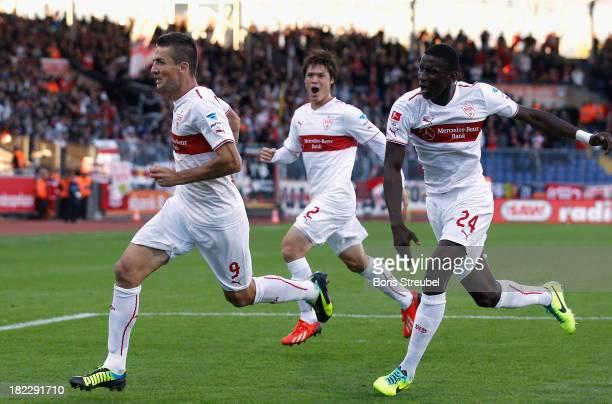 Vedad Ibisevic of Stuttgart celebrate his team's first goal with team mates during the Bundesliga match between Eintracht Braunschweig and VfB...