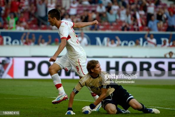 Vedad Ibisevic of Stuttgart celebrates after scoring his team's first goal during the UEFA Europa League Qualifying PlayOff match between VfB...