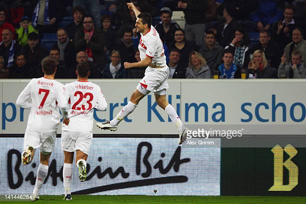 Vedad Ibisevic of Stuttgart celebrates his team's first goal with team mates Julian Schieber and Martin Harnik during the Bundesliga match between...