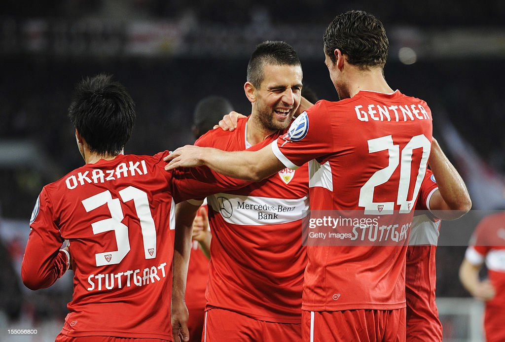 <a gi-track='captionPersonalityLinkClicked' href=/galleries/search?phrase=Vedad+Ibisevic&family=editorial&specificpeople=535857 ng-click='$event.stopPropagation()'>Vedad Ibisevic</a> of Stuttgart celebrates his team's second goal with team members <a gi-track='captionPersonalityLinkClicked' href=/galleries/search?phrase=Shinji+Okazaki&family=editorial&specificpeople=4320771 ng-click='$event.stopPropagation()'>Shinji Okazaki</a> (L) and <a gi-track='captionPersonalityLinkClicked' href=/galleries/search?phrase=Christian+Gentner&family=editorial&specificpeople=228707 ng-click='$event.stopPropagation()'>Christian Gentner</a> (R) during the second round match of the DFB Cup between VfB Stuttgart and FC St. Pauli at Mercedes-Benz Arena on October 31, 2012 in Stuttgart, Germany.