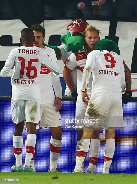 Vedad Ibisevic of Stuttgart celebrates his team's third goal with team mates during the Bundesliga match between VfB Stuttgart and FC Schalke 04 at...
