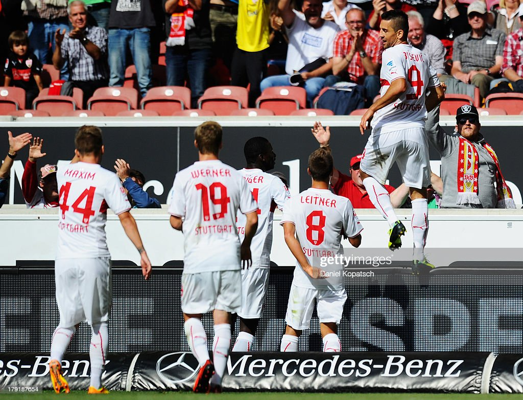 Vedad Ibisevic of Stuttgart (R) celebrates scoring his team's second goal with team mates during the Bundesliga match between VfB Stuttgart and 1899 Hoffenheim at Mercedes-Benz Arena on September 1, 2013 in Stuttgart, Germany.