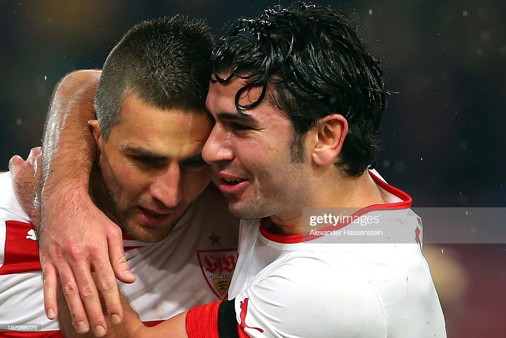 <a gi-track='captionPersonalityLinkClicked' href=/galleries/search?phrase=Vedad+Ibisevic&family=editorial&specificpeople=535857 ng-click='$event.stopPropagation()'>Vedad Ibisevic</a> (L) of Stuttgart celebrates scoring the second team goal with his team mate <a gi-track='captionPersonalityLinkClicked' href=/galleries/search?phrase=Serdar+Tasci&family=editorial&specificpeople=787688 ng-click='$event.stopPropagation()'>Serdar Tasci</a> during the Bundesliga match between VfB Stuttgart and FC Augsburg at Mercedes-Benz Arena on November 28, 2012 in Stuttgart, Germany.