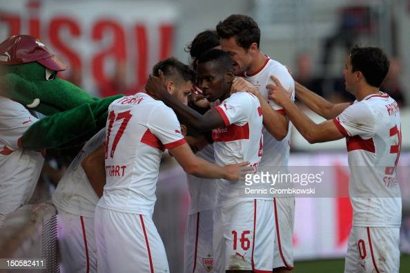Vedad Ibisevic of Stuttgart celebrates with teammates after scoring his team's first goal during the UEFA Europa League Qualifying PlayOff match...