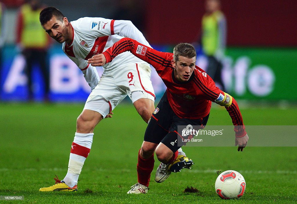 <a gi-track='captionPersonalityLinkClicked' href=/galleries/search?phrase=Vedad+Ibisevic&family=editorial&specificpeople=535857 ng-click='$event.stopPropagation()'>Vedad Ibisevic</a> of Stuttgart challenges <a gi-track='captionPersonalityLinkClicked' href=/galleries/search?phrase=Lars+Bender&family=editorial&specificpeople=644948 ng-click='$event.stopPropagation()'>Lars Bender</a> of Leverkusen during the Bundesliga match between Bayer 04 Leverkusen and VfB Stuttgart at BayArena on March 2, 2013 in Leverkusen, Germany.
