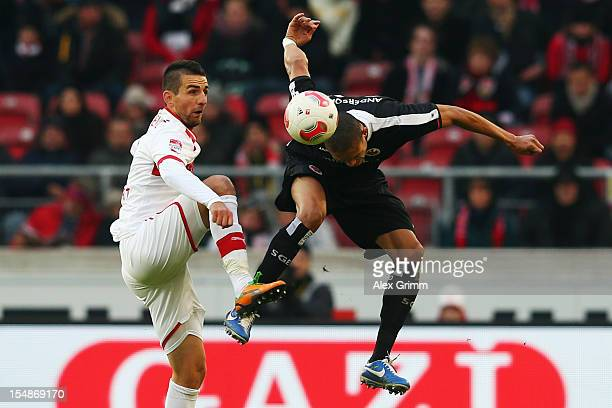 Vedad Ibisevic of Stuttgart is challenged by Bamba Anderson of Frankfurt during the Bundesliga match between VfB Stuttgart and Eintracht Frankfurt at...