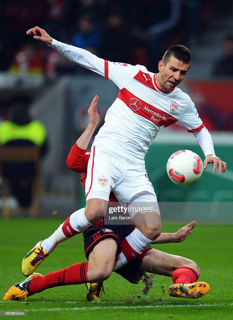 Vedad Ibisevic of Stuttgart is challenged by Daniel Schwaab of Leverkusen during the Bundesliga match between Bayer 04 Leverkusen and VfB Stuttgart at BayArena on March 2, 2013 in Leverkusen, Germany.