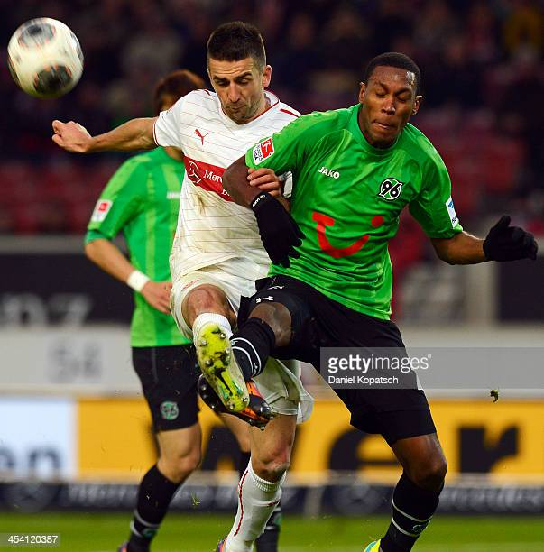 Vedad Ibisevic of Stuttgart is challenged by Marcelo of Hannover during the Bundesliga match between VfB Stuttgart and Hannover 96 at MercedesBenz...