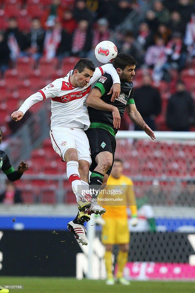 Vedad Ibisevic (L) of Stuttgart jumps for a headder with Sokratis (R) of Bremen during the Bundesliga match between VfB Stuttgart and Werder Bremen at Mercedes-Benz Arena on February 9, 2013 in Stuttgart, Germany.