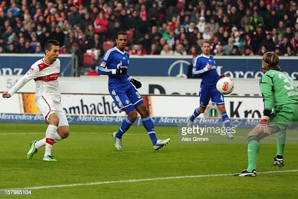 Vedad Ibisevic of Stuttgart scores his team's first goal against goalkeeper Timo Hildebrand of Schalke during the Bundesliga match between VfB...