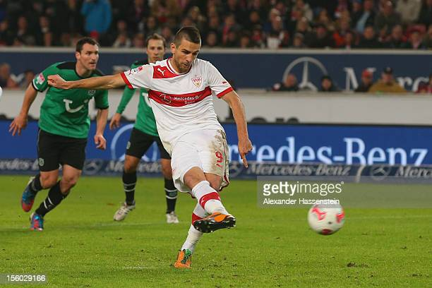Vedad Ibisevic of Stuttgart scores the 2nd team goal with a penalty kick during the Bundesliga match between VfB Stuttgart and Hannover 96 at...