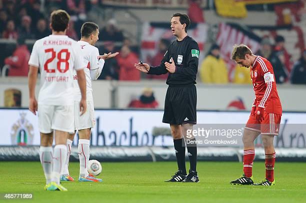 Vedad Ibisevic of VfB Stuttgart argues with referee Manuel Graefe during the Bundesliga match between VfB Stuttgart and FC Bayern Muenchen at...