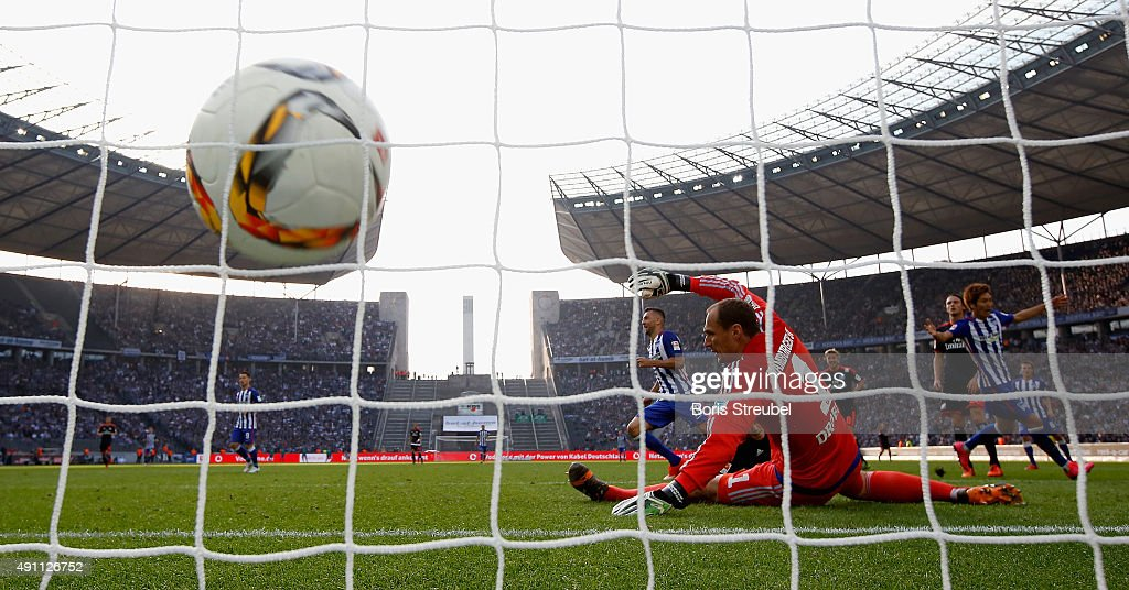 Vedad Ibisevic (C) scores his team's third goal against goalkeeper Jaroslav Drobny (R) of Hamburger SV during the Bundesliga match between Hertha BSC and Hamburger SV at Olympiastadion on October 3, 2015 in Berlin, Germany.