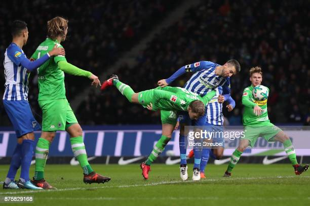 Vedad Ibisevicof Berlin heads the ball against Matthias Ginter of Moenchengladbach during the Bundesliga match between Hertha BSC and Borussia...